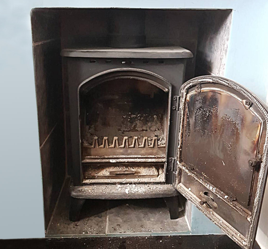 Log burner before chimney sweep